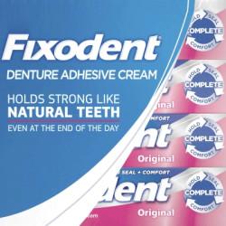 Клейкий крем для зубних протезів